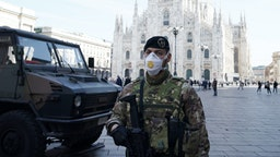An Italian soldier is wearing a fpp3 mask in Duomo Square on February 24, 2020 in Milan, Italy. Italian government takes security measures in Lombardy Region to counter the spread of the COVID-19 coronavirus.