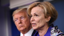 Deborah Birx, coronavirus response coordinator, speaks while U.S. President Donald Trump, left, listens during a Coronavirus Task Force news conference in the briefing room of the White House in Washington, D.C., U.S., on Wednesday, March 18, 2020.