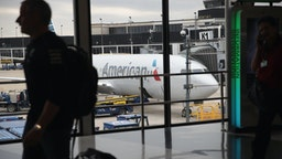 An American Airlines aricraft sits at a gate at O'Hare International Airport on May 11, 2018 in Chicago, Illinois.