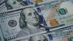 Photo taken on March 17, 2020 shows U.S. dollar banknotes in Washington D.C., the United States.