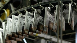 Freshly printed copies of the San Francisco Chronicle roll off the printing press at one of the Chronicle's printing facilities September 20, 2007 in San Francisco, California.