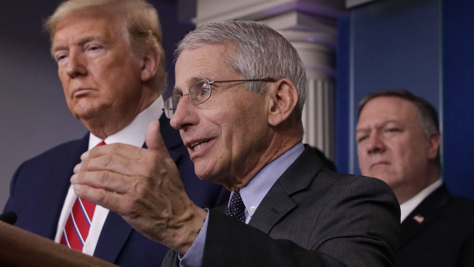 Dr. Anthony Fauci (C) director of the National Institute of Allergy and Infectious Diseases speaks while U.S. President Donald Trump (L) and Secretary of State Mike Pompeo (R) listen during a briefing on the latest development of the coronavirus outbreak in the U.S. in the James Brady Press Briefing Room at the White House March 20, 2020 in Washington, DC. With deaths caused by the coronavirus rising and foreseeable economic turmoil, the Senate is working on legislation for a $1 trillion aid package to deal with the COVID-19 pandemic. President Trump announced that tax day will be delayed from April 15 to July 15. (Photo by Alex Wong/Getty Images)