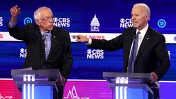 CHARLESTON, SOUTH CAROLINA - FEBRUARY 25: Democratic presidential candidate former Vice President Joe Biden speaks as Sen. Bernie Sanders (I-VT) (L) looks on during the Democratic presidential primary debate at the Charleston Gaillard Center on February 25, 2020 in Charleston, South Carolina. Seven candidates qualified for the debate, hosted by CBS News and Congressional Black Caucus Institute, ahead of South Carolina's primary in four days.