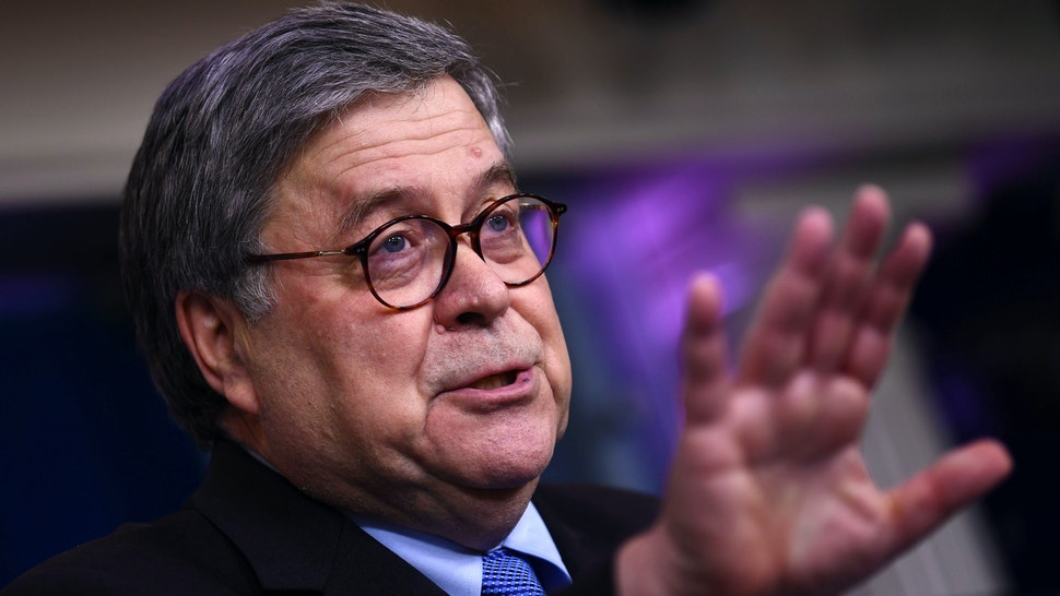 US Attorney General William Barr gestures as he speaks during the daily briefing on the novel coronavirus, COVID-19, at the White House, March 23, 2020, in Washington, DC.