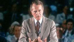 46113 02: Vice President speaks October 6, 1987 in Iowa. Bush and his running mate Dan Quayle defeat Michael Dukakis the following year in the Presidential election. His efforts to reduce the deficit failed while creating the lowest growth period since the Great Depression.
