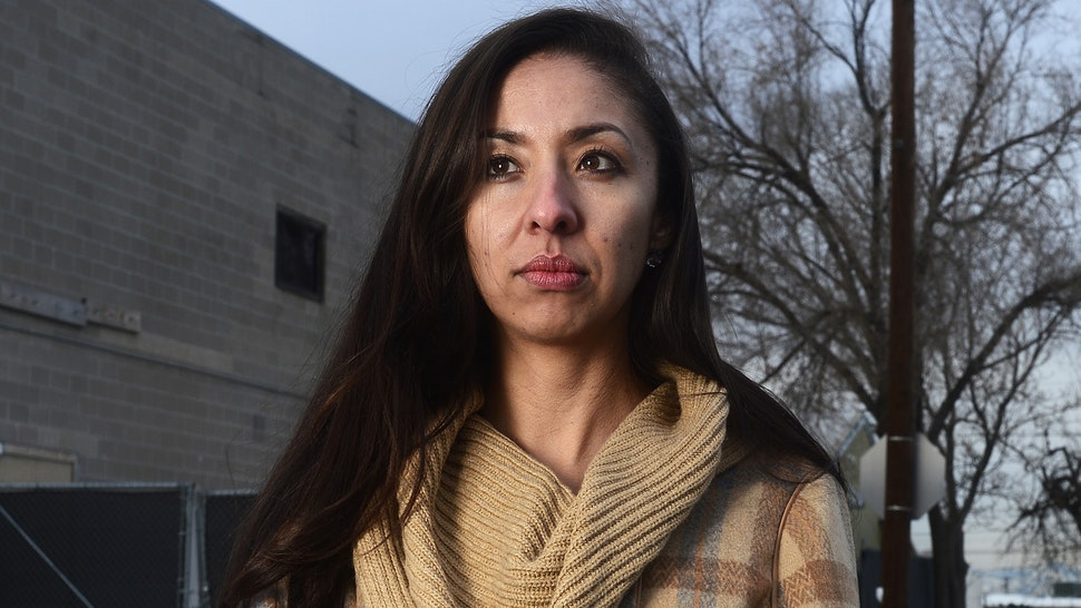 DENVER, CO - DECEMBER 22: Community organizer Candi CdeBaca stands outside of a warehouse that was in use as a marijuana grow facility December 22, 2015 in Denver, Colorado. CdeBaca is part of a group that is against the amount of marijuana operations in low income and heavily minority neighborhoods. One of the fears of the legalization of marijuana was that pot businesses would find places to call home in low income, mostly minority neighborhoods, which according to some is exactly what happened.