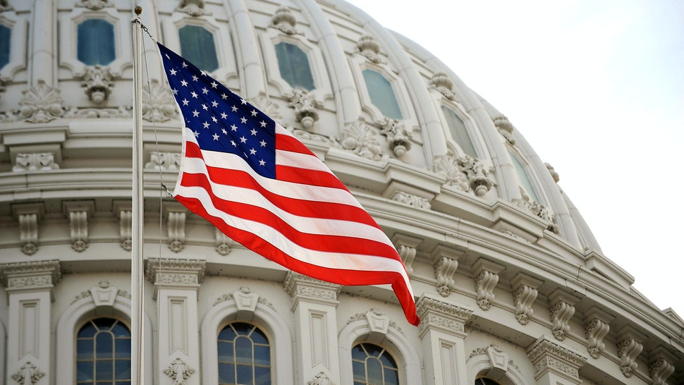 The US flag flies at the US Capitol in Washington, DC, January 20, 2009. Millions of people are expected to be in the US capital to witness the swearing of Barack Obama as 44th President of the United States.