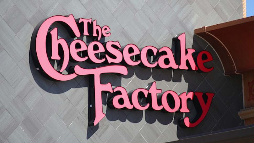 HUNTINGTON STATION, NEW YORK - MARCH 26: A general view of the Cheesecake Factory logo on their restaurant in the Walt Whitman Mall on March 26, 2020 in Huntington Station, New York. Across the country schools, businesses and places of work have either been shut down or are restricting hours of operation as health officials try to slow the spread of COVID-19.
