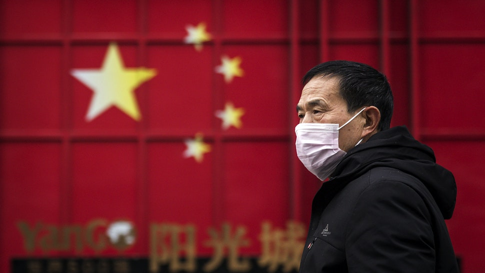 WUHAN, CHINA - FEBRUARY 10: A man wears a protective mask on February 10, 2020 in Wuhan, China. Flights, trains and public transport including buses, subway and ferry services have been closed for the nineteenth day. The number of those who have died from the Wuhan coronavirus, known as 2019-nCoV, in China climbed to 909.