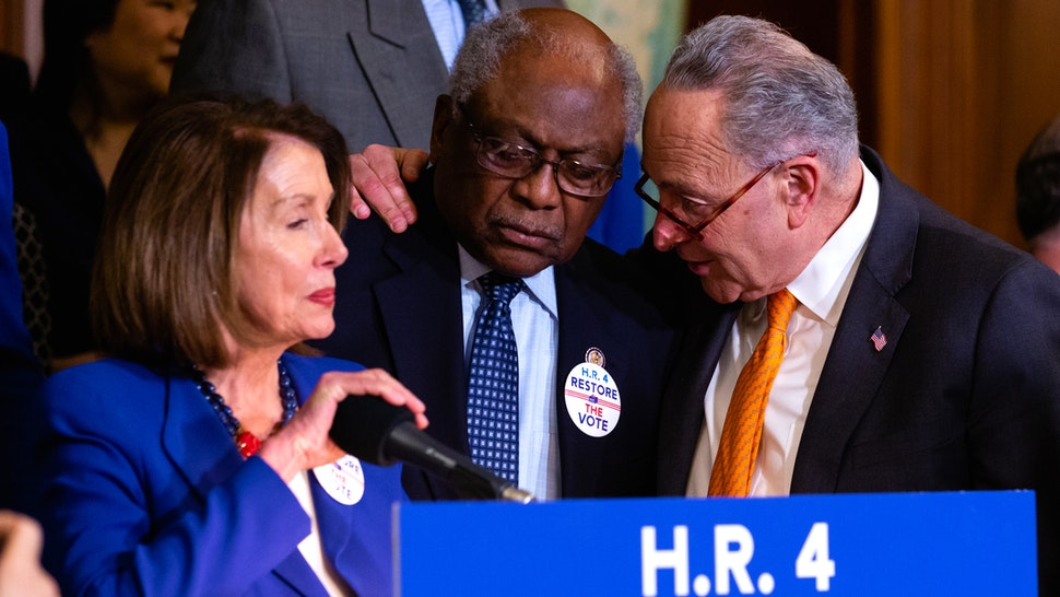 House Majority Whip James Clyburn (D-SC), (C), and Senate Minority Leader Sen. Chuck Schumer (D-NY), (R), speak before a news conference to introduce H.R. 4, Voting Rights Advancement Act, on Capitol Hill in Washington, DC, on Tuesday, Feb. 26, 2019.