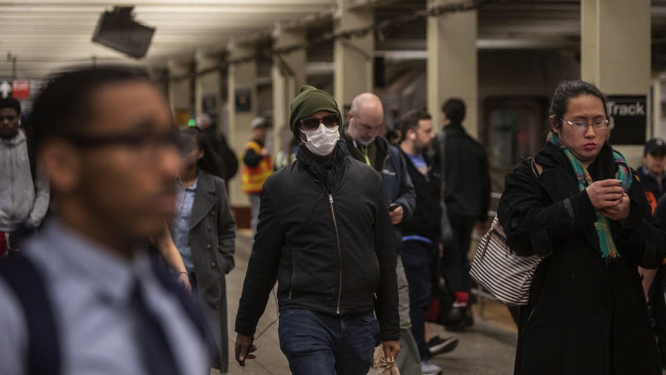 A commuter wears a mask while walking through a subway station in New York, U.S., on Monday, March 9, 2020. In a series of tweets Sunday, New Yorkers were encouraged by MayorBill de Blasioto avoid the busiest times of thesubwayand bus rush hour by telecommuting, staggering work schedules or walking or biking to work ascasesof the coronavirus climb. Photographer: Victor J. Blue/Bloomberg