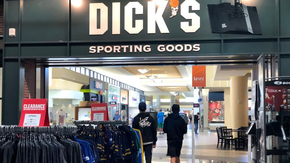 Customers leave a Dick's Sporting Goods store on May 29, 2019 in Daly City, California. Shares of Dick's Sporting Goods stock surged on Wednesday after the company reported better-than-expected first quarter earnings and raised its full year outlook. The sporting goods retailer announced that it expects to earn from $3.20 to $3.40 a share, compared to its estimate of $3.15 to $3.35 per share. (Photo by Justin Sullivan/Getty Images)