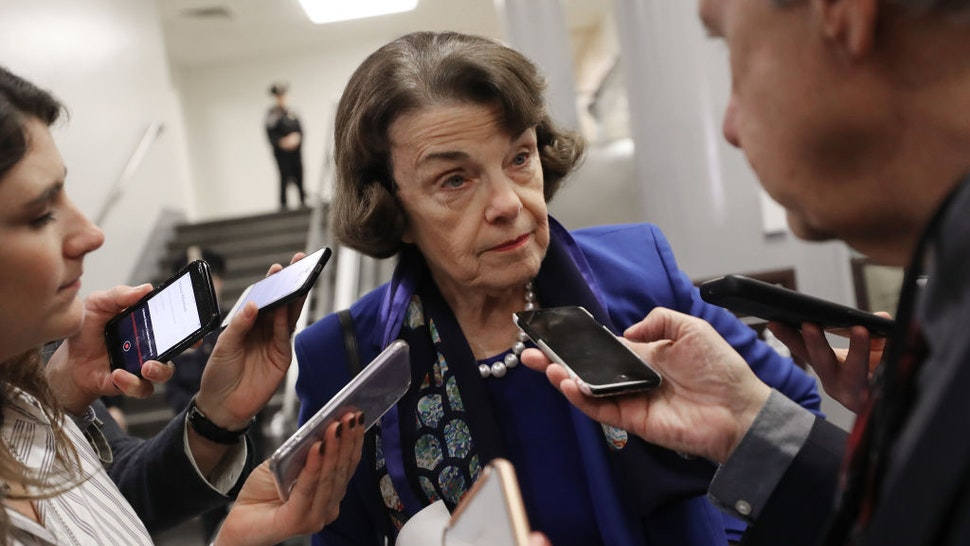 Sen. Dianne Feinstein (D-CA) speaks to reporters while departing the U.S. Capitol after the Senate impeachment trial adjourned for the day on January 28, 2020 in Washington, DC. President Donald Trump's legal defense team concluded their arguments today and will begin answering written questions from Senators on Wednesday. (Photo by Mario Tama/Getty Images)
