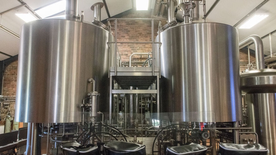 Two metal storage vats containing beer at microbrewery, Cape Town, South Africa. (Photo by: Edwin Remsberg/VW PICS/UIG via Getty Image)