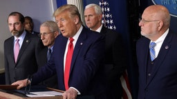 U.S. President Donald Trump speaks as Health and Human Services Secretary Alex Azar, National Institute for Allergy and Infectious Diseases Director Anthony Fauci, Vice President Mike Pence, and Centers for Disease Control and Prevention Director Robert Redfield listen during a news conference at the James Brady Press Briefing Room at the White House February 29, 2020 in Washington, DC. Department of Health in Washington State has reported the first death in the U.S. related to the coronavirus. (Photo by Alex Wong/Getty Images)