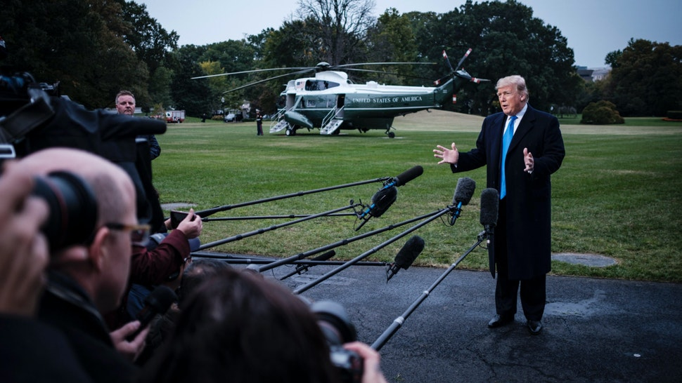 US President Donald Trump speaks to the media as he prepares to board Marine One on the South Lawn of the White House on October 26, 2018 in Washington, DC.