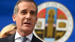 "Los Angeles Mayor Eric Garcetti speaks at a Los Angeles County Health Department press conference on the novel coronavirus, (COVID-19)on March 4, 2020 in Los Angeles, California. - Stressing that they were acting out of ""an abundance of caution"" Los Angeles County officials today declared a state of emergency for the novel coronavirus, as six new cases of the disease were revealed in the county in the last 48 hours."