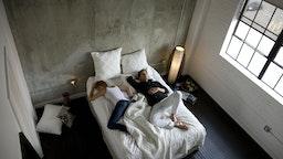 USA, Utah, Salt Lake City, Couple sleeping on bed, elevated view - stock photo