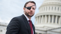 Rep.-elect Dan Crenshaw, R-Texas, is seen after the freshman class photo on the East Front of the Capitol on November 14, 2018.