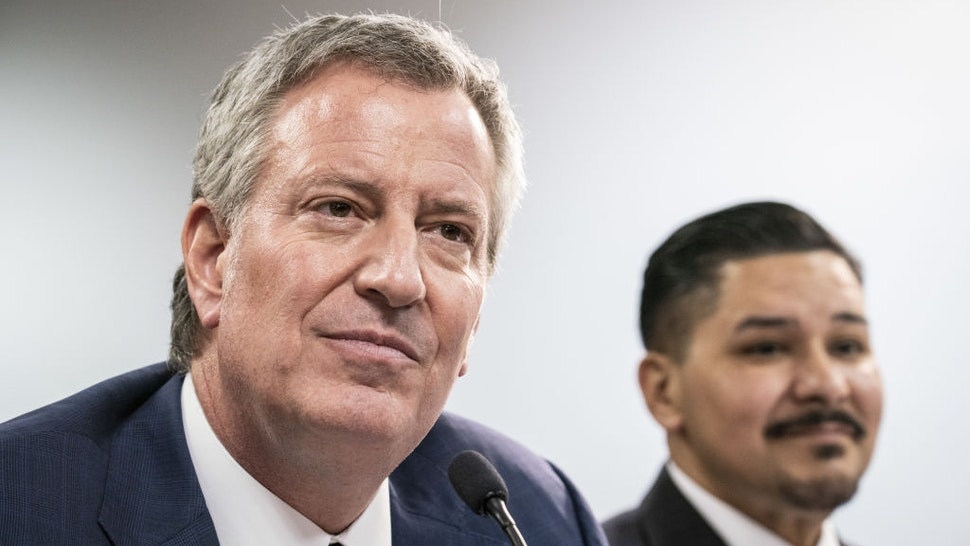 Bill de Blasio, mayor of New York, left, and Richard Carranza, chancellor of the New York City Department of Education, listen during a public hearing on school governance and mayoral control in New York, U.S., on Friday, March 15, 2019.