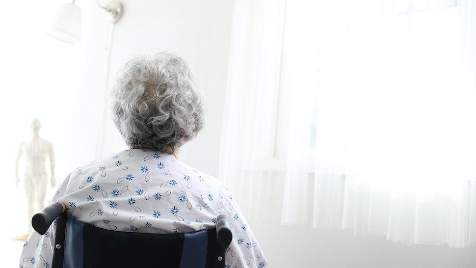 Senior woman in wheelchair,rear view