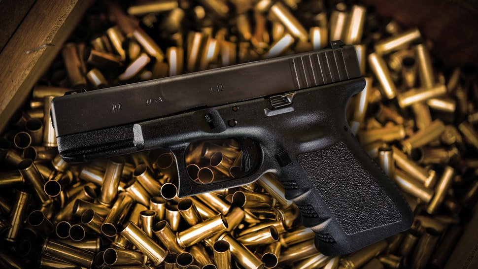 High Angle View Of Gun And Bullets - stock photo