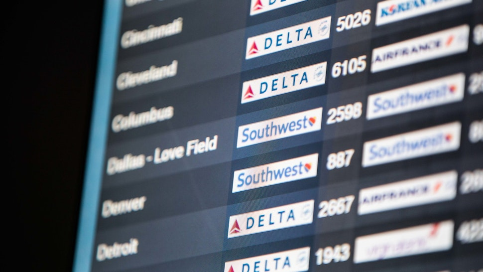 Southwest Airlines Co. flight information is displayed on a screen at Logan International Airport (BOS) in Boston, Massachusetts, U.S., on Friday, July 19, 2019. Southwest Airlines is scheduled to release earnings figures on July 25. Photographer: Scott Eisen/Bloomberg via Getty Images