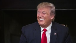 """U.S. President Donald Trump laughs during the """"Pledge to America's Workers"""" event at the White House in Washington, D.C., U.S., on Thursday, July 25, 2019."""