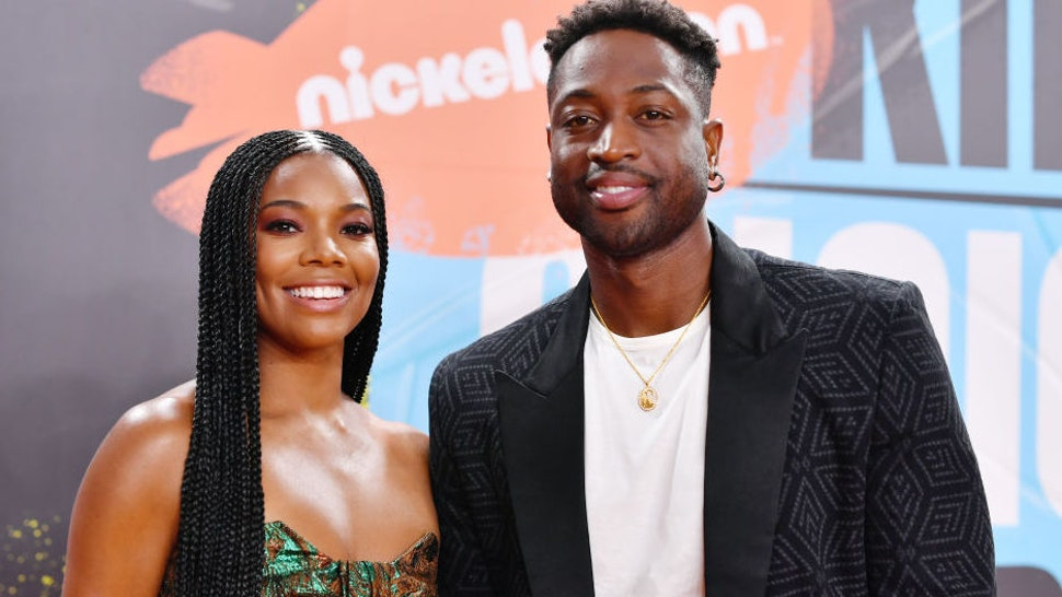 Gabrielle Union and Dwyane Wade attend Nickelodeon Kids' Choice Sports 2019 at Barker Hangar on July 11, 2019 in Santa Monica, California.