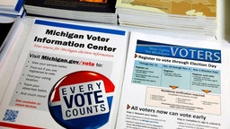 Voting literature is placed on the table at the NAACP office in Detroit, Michigan, on October 23, 2019.