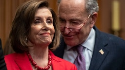 Speaker of the House Nancy Pelosi (D-CA) and Senate Minority Leader Chuck Schumer (D-NY) speak with each other at a press conference with DACA recipients to discuss the Supreme Court case involving Deferred Action for Childhood Arrivals (DACA) at the U.S. Capitol on November 12, 2019 in Washington, DC.