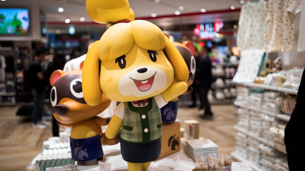 Goods of Nintendo game character Isabelle, known as Shizue in Japan, from the Animal Crossing series of video games are displayed at a new Nintendo store during a press preview in Tokyo on November 19, 2019.