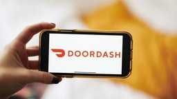 Doordash Inc. signage is displayed on an Apple Inc. iPhone in an arranged photograph taken in the Brooklyn borough of New York, U.S., on Friday, Jan. 10, 2020.