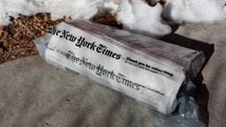 home-delivered copy of The New York Times on a driveway in Santa Fe, New Mexico.