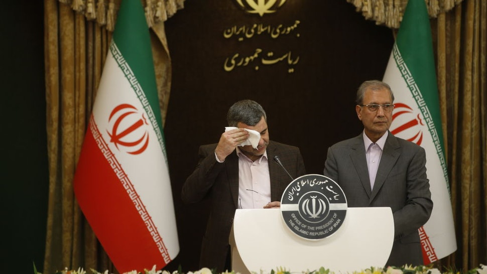 Iranian Deputy Health Minister Iraj Harirchi (L) wipes his sweating as he speaks on his tests positive for coronavirus as he holds a press conference with Iranian Government spokesman and Spokesperson for the Prevention and Struggle for Corona, created by Iranian President Hassan Rouhani, Ali Rabiei (R) in Tehran, Iran on February 24, 2020.
