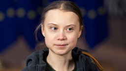 Swedish environmental activist on climate change Greta Thunberg is talking to media as she arrives for an EU environment Council at the Europa, the European Council headquarter, on March 5, 2020, in Brussels, Belgium.