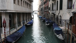 """A completely empty canal with unused Gondole is seen on March 9, 2020 in Venice, Italy. Prime Minister Giuseppe Conte announced a """"national emergency"""" due to the coronavirus outbreak and imposed quarantines on the Lombardy and Veneto regions, which contain roughly a quarter of the country's population."""