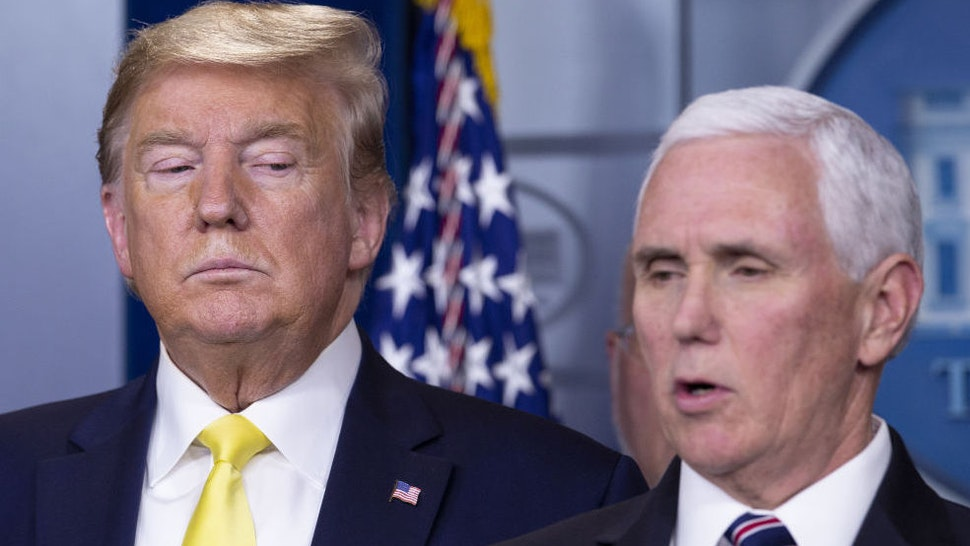 U.S. President Donald Trump, left, listens as Vice President Mike Pence speaks during a news conference in Washington, D.C., U.S., on Monday, March 9, 2020.
