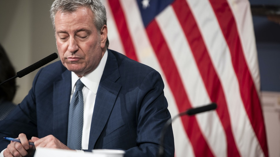 Bill de Blasio, mayor of New York, pauses while speaking during a news conference on COVID-19 in New York, U.S., on Friday, March 13, 2020. On Thursday, Mayor de Blasio declared a state of emergency for New York City, saying the city would work with the state to enforce its decree against gatherings of more than 500 people to combat the new coronavirus outbreak. Photographer: Mark Kauzlarich/Bloomberg via Getty Images