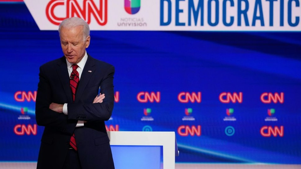 Democratic presidential hopeful former US vice president Joe Biden is seen on stage as he and Senator Bernie Sanders take part in the 11th Democratic Party 2020 presidential debate in a CNN Washington Bureau studio in Washington, DC on March 15, 2020.