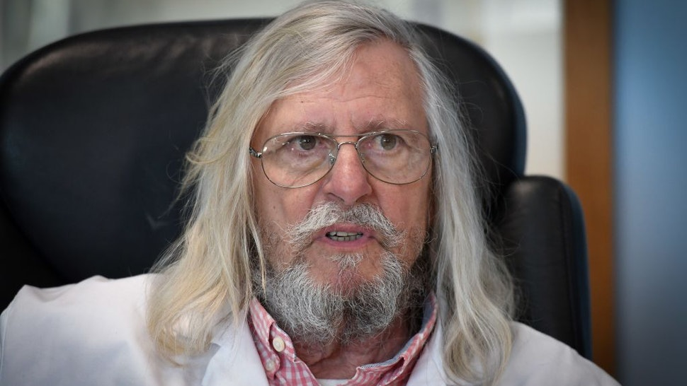 A picture taken on February 26, 2020 shows French professor Didier Raoult, biologist and professor of microbiology, specialized in infectious diseases and director of IHU Mediterranee Infection Institute posing in his office in Marseille, southeastern France.