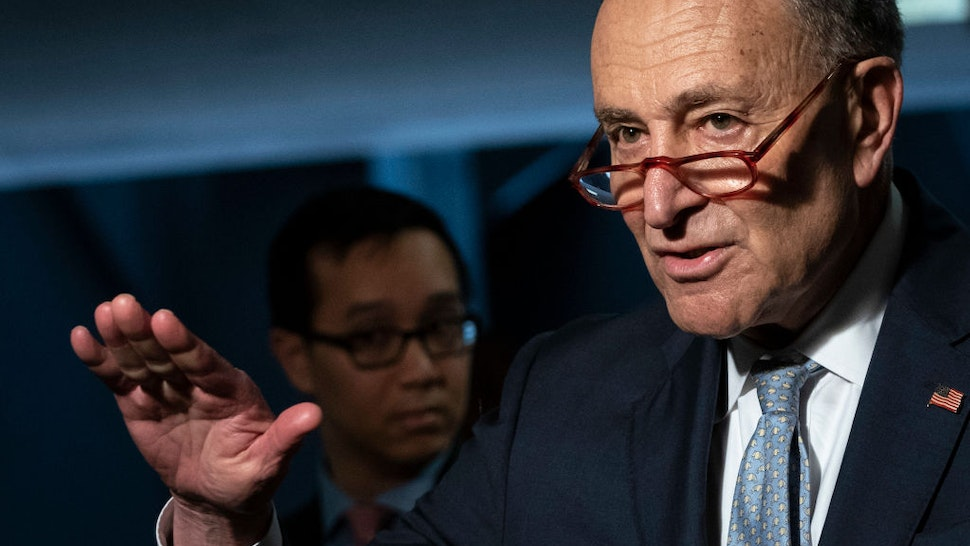 Senate Minority Leader Chuck Schumer (D-NY) speaks to reporters before a meeting with a select group of Senate Republicans, Senate Democrats, and Trump administration officials in the Hart Senate Office Building on Capitol Hill March 20, 2020 in Washington, DC.