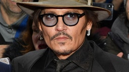 """Johnny Depp poses at the """"Minamata"""" premiere during the 70th Berlinale International Film Festival Berlin at Friedrichstadt-Palast on February 21, 2020 in Berlin, Germany."""