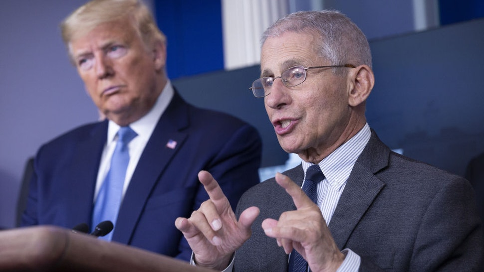 Anthony Fauci, director of the National Institute of Allergy and Infectious Diseases, right, speaks during a Coronavirus Task Force news conference in the briefing room of the White House in Washington, D.C., U.S., on Saturday, March 21, 2020.