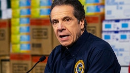 New York Governor Andrew Cuomo speaks to the media at the Javits Convention Center which is being turned into a hospital to help fight coronavirus cases on March 24, 2020 in New York City.