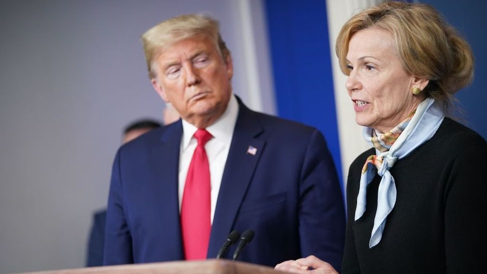 Response coordinator for White House Coronavirus Task Force Deborah Birx speaks, while US President Donald Trump listens, during the daily briefing on the novel coronavirus, COVID-19, at the White House on March 24, 2020, in Washington, DC.