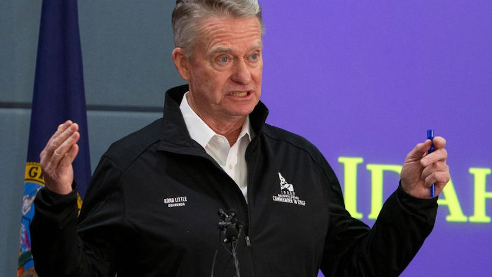 Gov. Brad Little issues a statewide stay-at-home order to further prevent spread of coronavirus COVID-19 at a press conference Wednesday, March 25, 2020 held at Gowen Field, headquarters of the Idaho Army National Guard in Boise, Idaho.