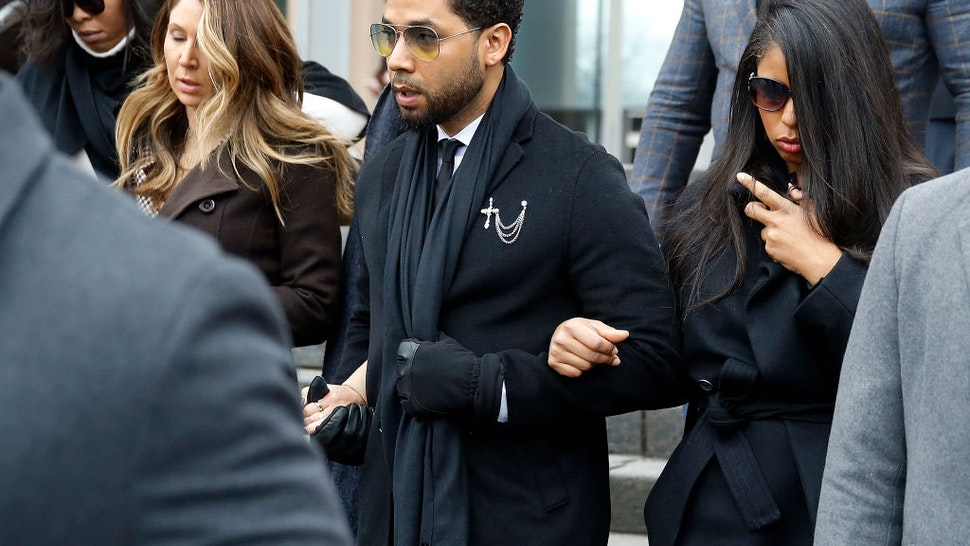 Flanked by attorneys and supporters, actor Jussie Smollett walks out of the Leighton Criminal Courthouse today after pleading not guilty to a new indictment on February 24, 2020 in Chicago, Illinois.
