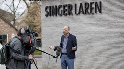 """Singer Laren Museum Evert van Os speaks to the press outside the museum on March 30, 2020 in Laren, about 30 kilometres southeast of Amsterdam, closed to the public because of the COVID-19 pandemic, after th 1884 painting by Vincent van Gogh """"Parsonage Garden at Neunen in Spring"""" was stolen. - The painting has an estimated value of between one to six million euros, local media said. The criminals entered the museum at around 3.15 am (0115 GMT) by breaking open a front glass door, police and Dutch news reports said. (Photo by Robin VAN LONKHUIJSEN / ANP / AFP) / Netherlands OUT (Photo by ROBIN VAN LONKHUIJSEN/ANP/AFP via Getty Images)"""