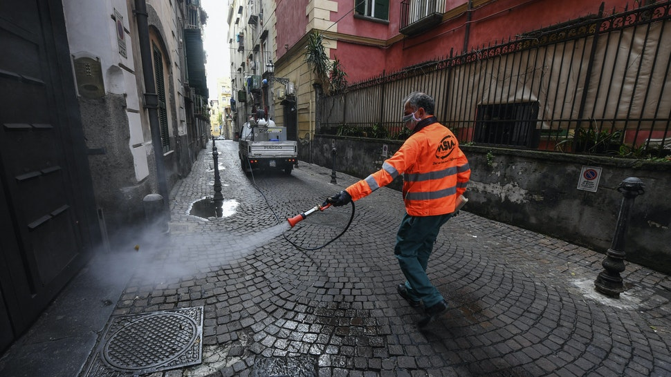 APLES, CAMPANIA, ITALY - 2020/03/31: Sanitary workers disinfect the streets of Naples city to counter the danger of a coronavirus infection (COVID 19). (Photo by Salvatore Laporta/KONTROLAB/LightRocket via Getty Images)